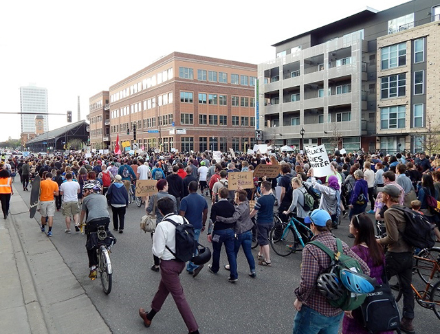 Eventually protesters take up both sides of Washington Avenue