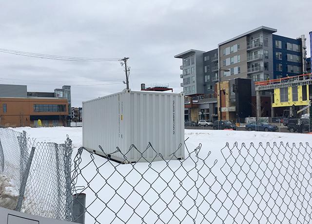 Empty lot next to the Calhoun Square shopping center