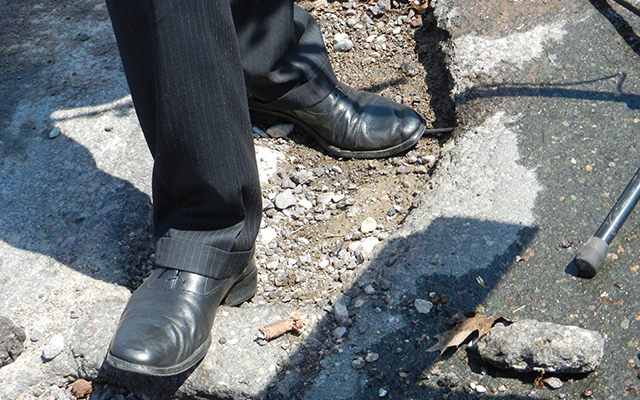 Cam Winton standing in a pothole