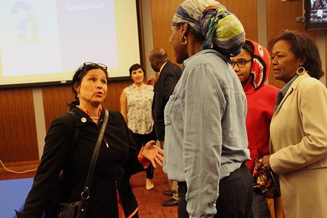 Finalist Brenda Cassellius speaking with board member Tracine Asberry