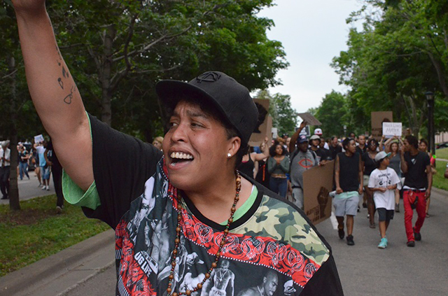 A demonstrator leads a chant along Lexington Parkway in St. Paul