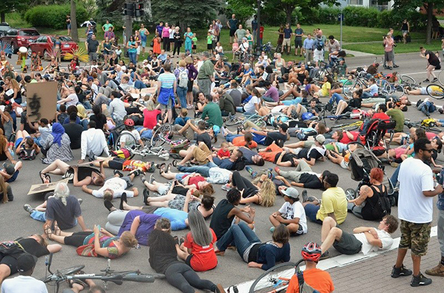 More than 100 demonstrators perform a 'die-in' at Lexington and Selby