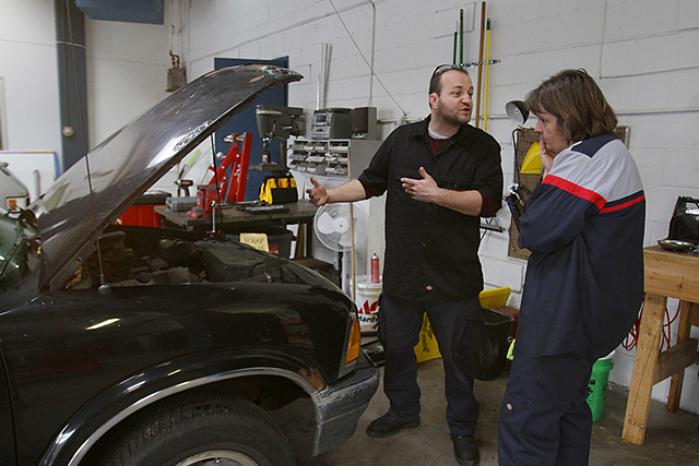 Staff mechanic John Buttner consulting with Cathy Heying