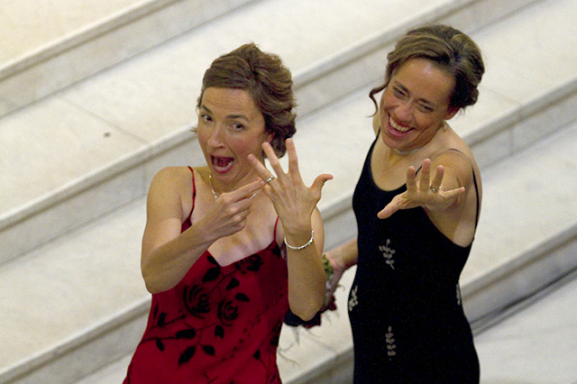 Cathy ten Broeke and Margaret Miles show off their rings and wave to well-wishers.