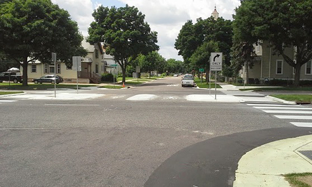 A median crossing on the Charles Avenue bike boulevard in St. Paul.