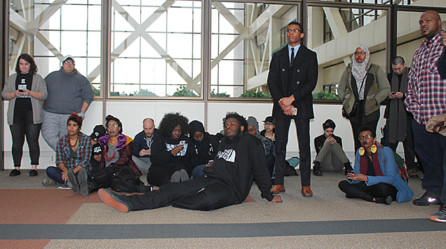 An overflow crowd sat on the floor at the Hennepin County Gov't Center