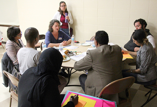 Facilitators, recorders and community members participating in Thursday night's