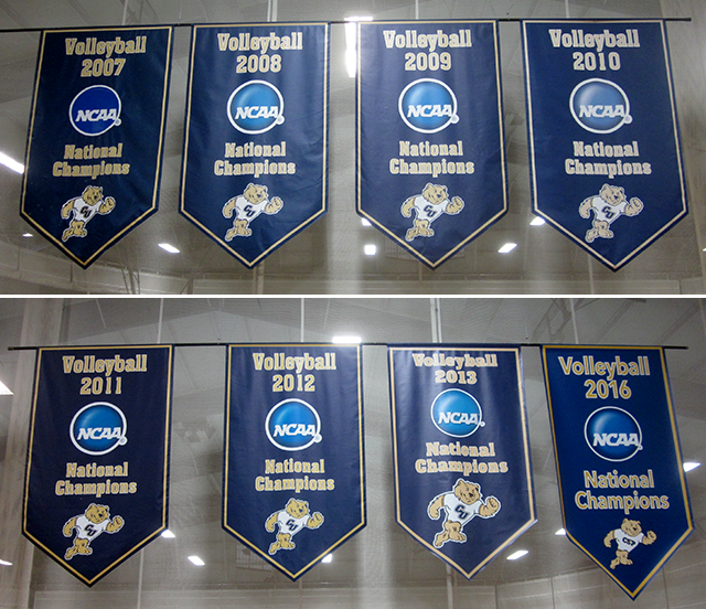 Women's volleyball championship banners adorn the court