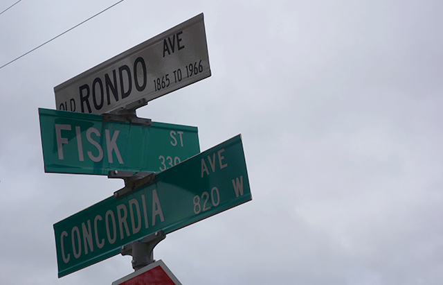 The Rondo, Concordia and Fisk street signs mark the corner overlooking I-94