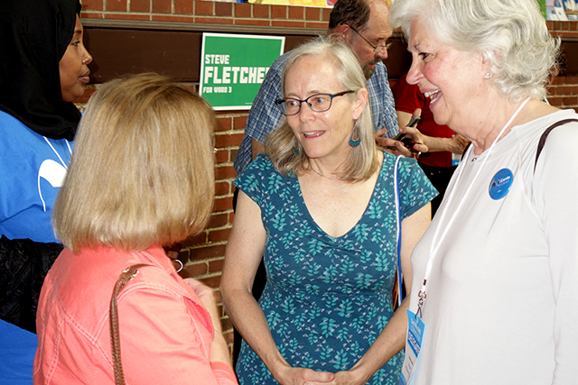 Ward 3 council candidate Cordelia Pierson chatting with convention attendees.