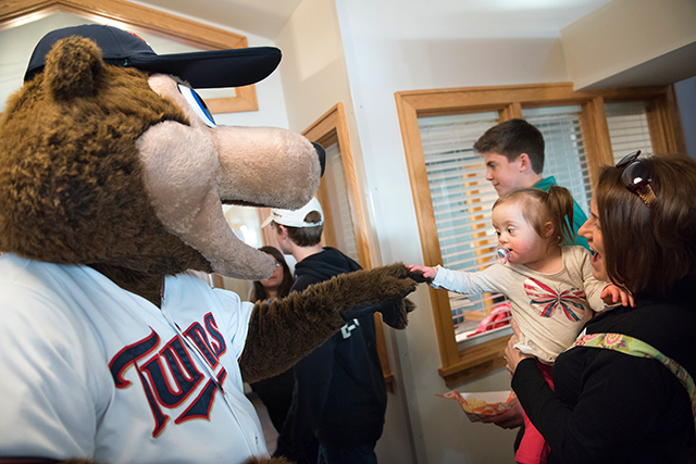 Serenity Torgerson meeting Twins mascot TC Bear at the open house.