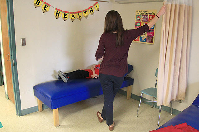School nurse Crystal Genelin tending to a student at Park Elementary