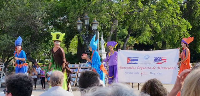 Cubans welcomed the orchestra's arrival with drums, signs and stilt walkers