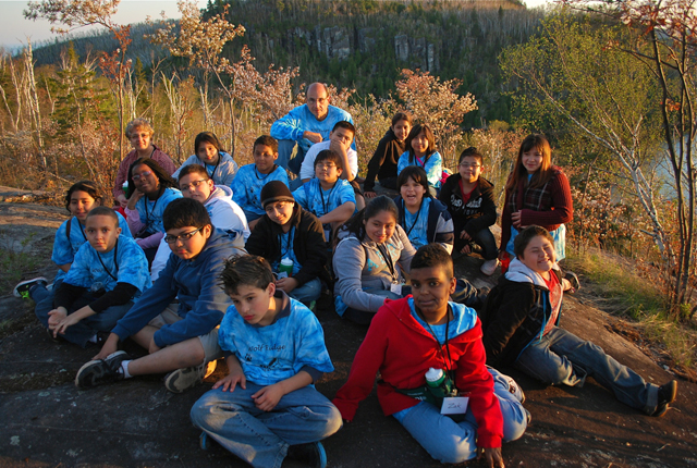 Mr. Date's class pauses to take in a sunset view from Marshall Mountain.