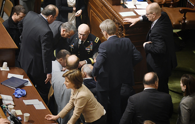 Gov. Mark Dayton being tended to following his collapse