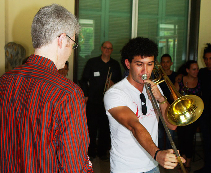 Orchestra trombonist Doug Wright, left, testing mouthpieces with a student.