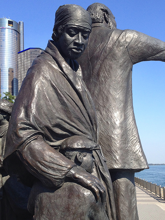 A detail of a statue honoring the end point of the Underground Railroad.