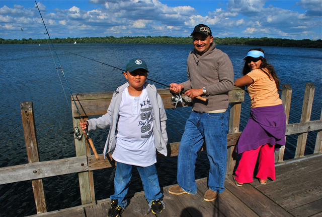 Donald Mendoza fishes with his son and daughter