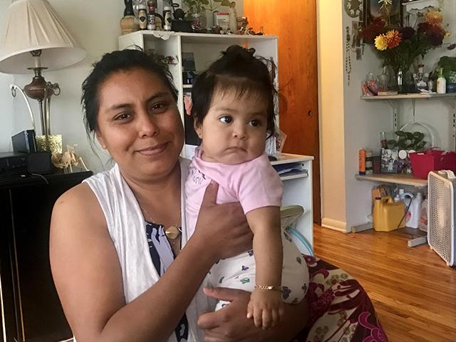 Minneapolis renter Flora Dominguez holding her daughter