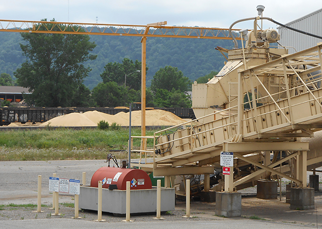 Piles of frac sand, background, at a processing facility in Winona.