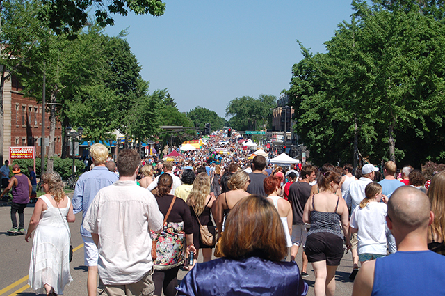 Grand Old Day attendees strolling down Grand Avenue in St. Paul.