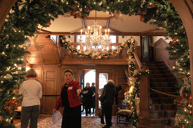 An archway near the entrance of the residence decorated for the holidays.