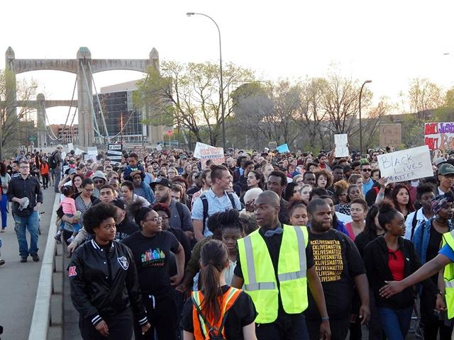 The marches crossing the Hennepin Avenue bridge.