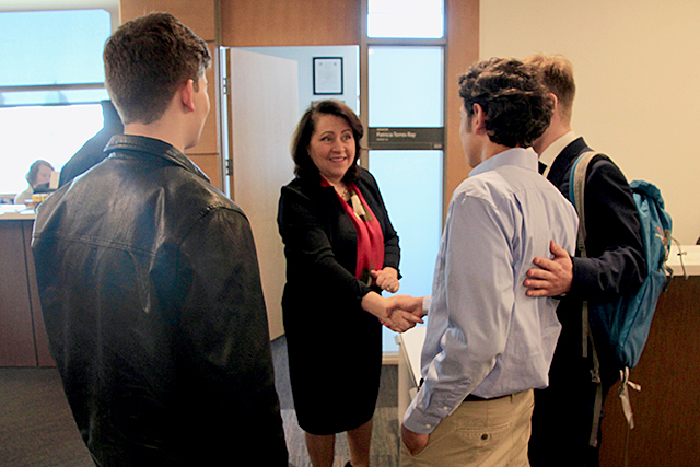 State Sen. Patricia Torres Ray greeting students in her Capitol office.