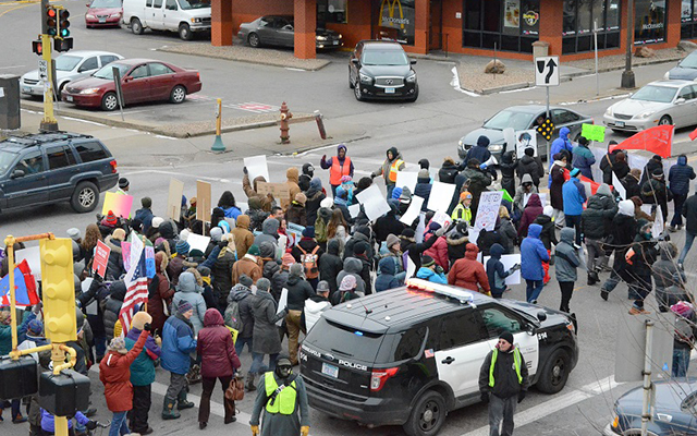 An estimated 150 attendees marched down Lake Street Saturday afternoon