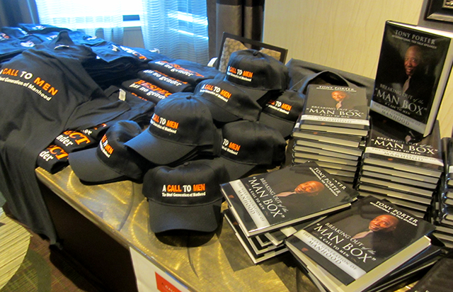 A Call To Men t-shirts and books on display at the conference.