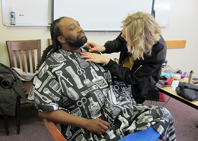 Vernis Mckizzie and volunteer hair stylist