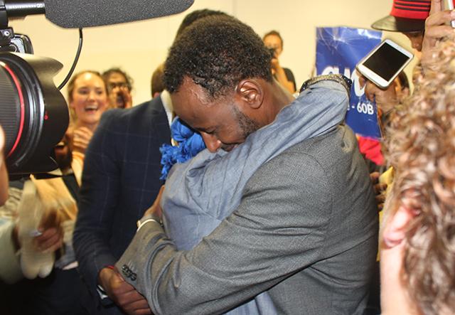 Ilhan Omar hugging her husband, Ahmed Hirsi