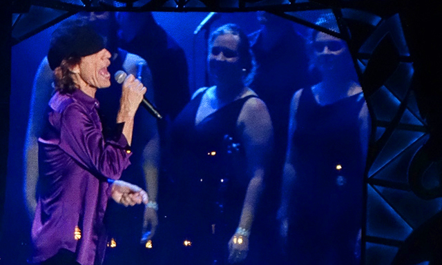 Mick Jagger performing with VocalEssence singers