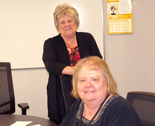 Jan Backlin (standing) and Judy Bond
