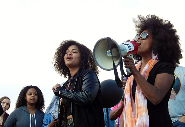 Activist and artist Jayanthi Kyle sings to the crowd.