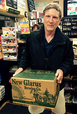 The author buying a case of Spotted Cow at a Wisconsin gas station