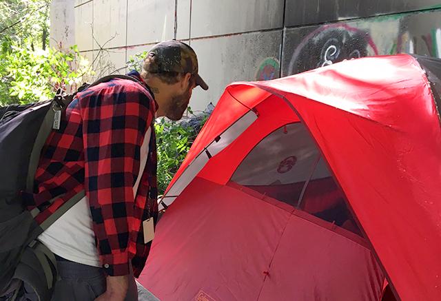 Dave Katzenmeyer talking to Nick through his tent flap.