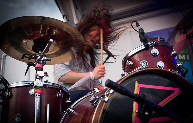 Matthew Kazama behind the drums.