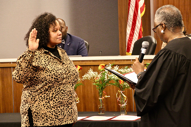 KerryJo Felder, left, being sworn in by Judge Pamela Alexander.