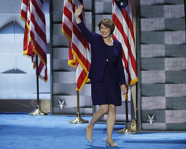Sen. Amy Klobuchar arriving onstage to speak at the DNC