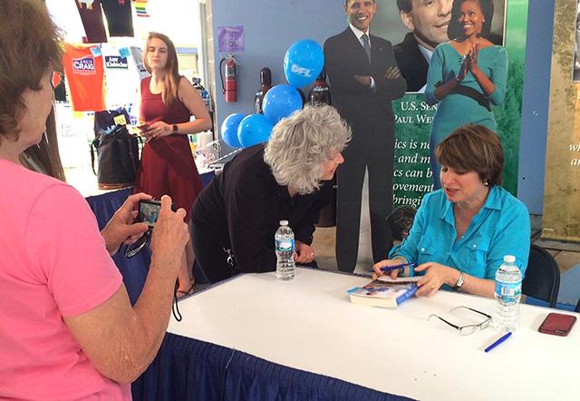 """Sen. Amy Klobuchar signing copies of her book, """"The Senator Next Door"""""""