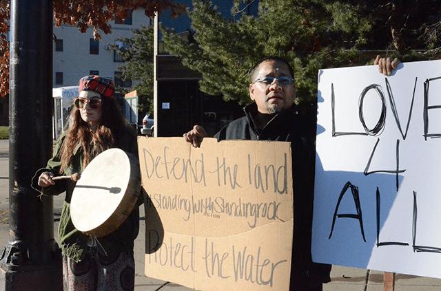 Kris Arredondo, right, part of the Dakota Sioux Tribe