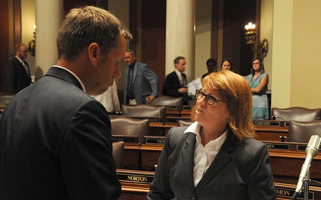 House Majority Leader Erin Murphy, right, speaking with House Minority Leader Kurt Daudt