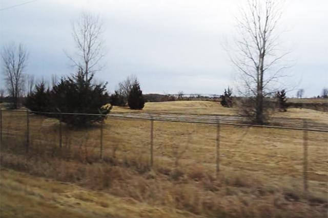 A fence surrounding the launch site outside St. Bonifacius.