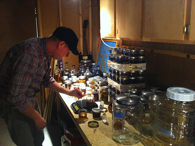 Lee Egbert, co-founder of 11 Wells, mixing up tinctures.