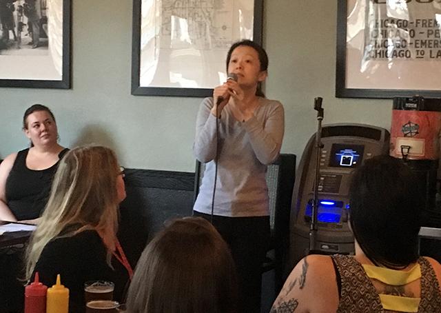 Lina Goh, co-owner of Zen Box Izakaya, speaking during Monday's meeting.