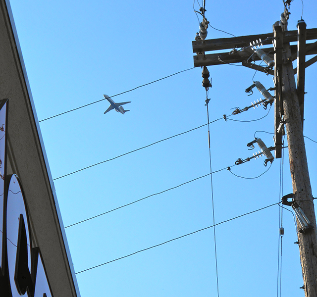 An airplane approaching the Minneapolis-St. Paul International Airport over Linden Hills