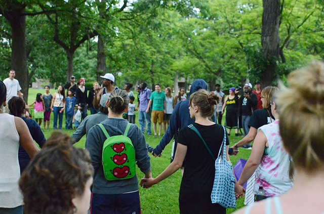 Protesters join hands at Loring Park in a moment of silence