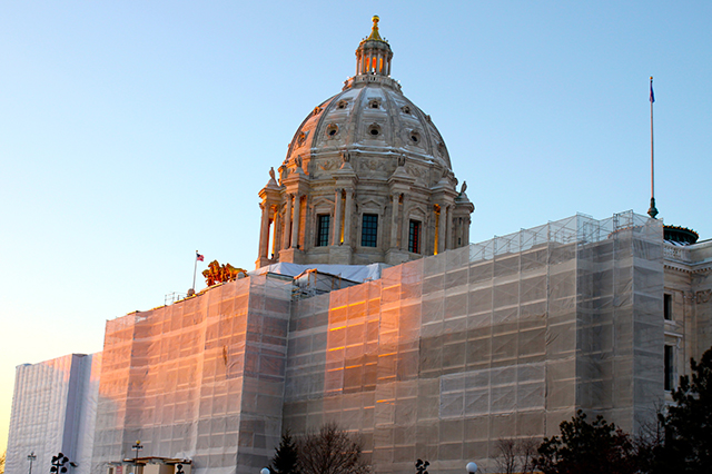 A 2015 photo of the Minnesota Capitol surrounded by scaffolding.