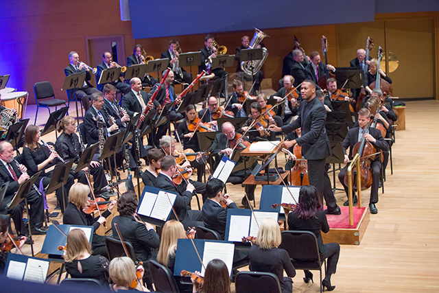 Roderick Cox conducting and the Minnesota Orchestra performing